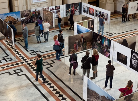 ethnography: Budapest, Hungary - October 11, 2012: People visit the World Press Photo exhibition in the Museum of Ethnography