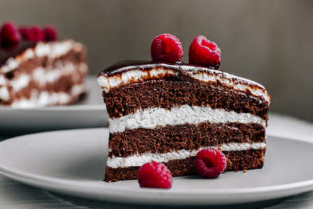 Chocolate cake decorated with raspberries in