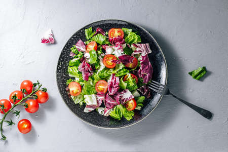 Mix healthy salad romaine,chard,spinash with tomatoess