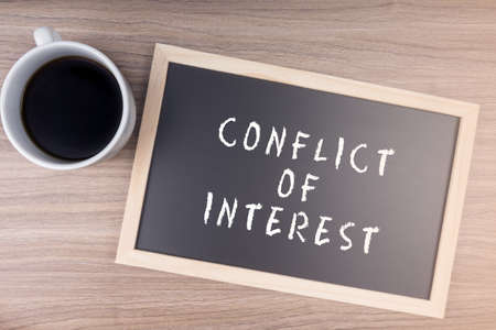 Conflict Of Interest word on chalkboard