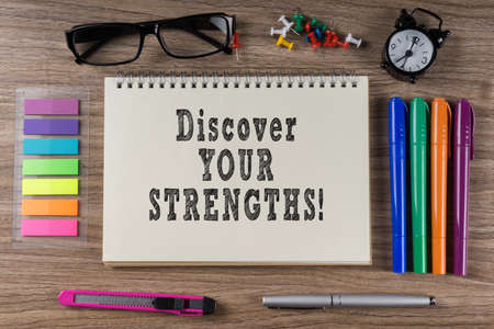 discover: Discover your Strengths word on notebook.