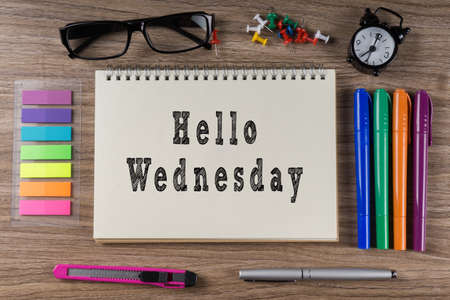 thursday: Hello Wednesday word on notebook. Business conceptual.