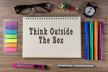 receptive: Think Outside The Box word on notebook. Stock Photo