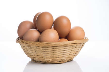 Eggs in the basket isolated on white background. Stock Photo