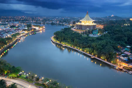Kuching city waterfront esplanade with iconic Sarawak State Legislative Assembly building. (Soft focus, slight motion blur)