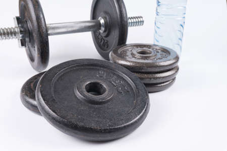 Fitness equipment : Training dumbbells and bottle of water isolated on white background.