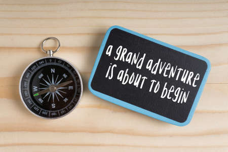 Travel inspirational quote with phrase 'a grand adventure  is about to begin'. Stock Photo