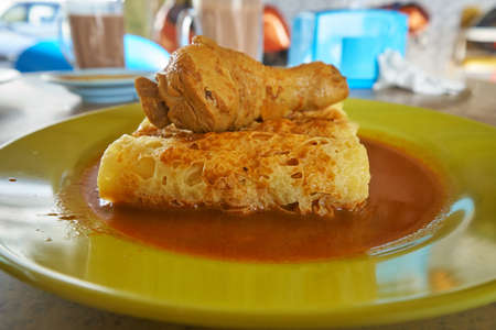 Roti Jala serves with chicken curry which one of the popular cuisine in malaysian. Stock Photo