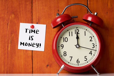 Clock On Wooden Table - Time Is Money