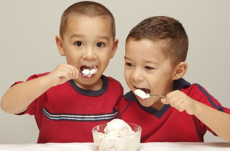 devour: Two preschool brothers attack a large bowl of strawberry-cheesecake ice cream