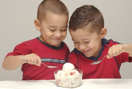 devour: Two preschool brothers prepare to enjoy a large bowl of strawberry-cheesecake