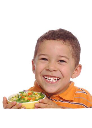 Boy Smiling over Vegetables photo