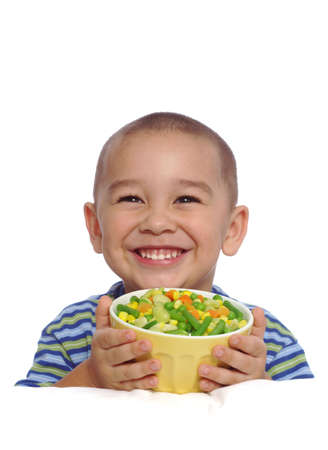 Smiling boy holding a bowl of mixed vegetables Stock Photo - 553296