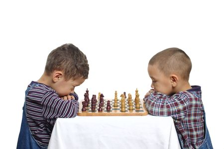 Two young brothers playing a game of chess