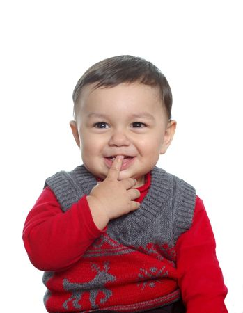 saliva: Teething toddler boy wearing a sweater Stock Photo