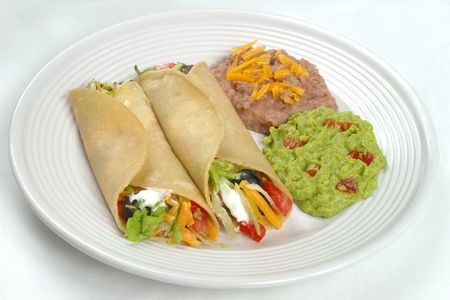 Mexican food - tacos, beans, and guacamole photo