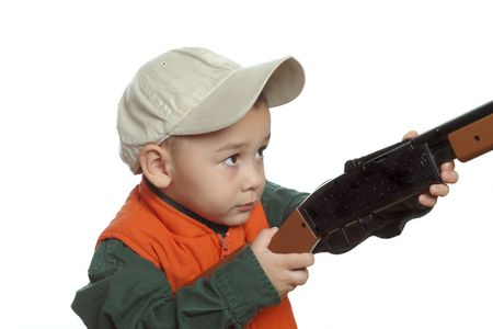 Young boy playing with a toy gun, isolated on white Stock Photo - 631407