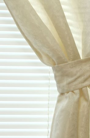 slightly: Closeup of an interior curtain and slightly open blinds
