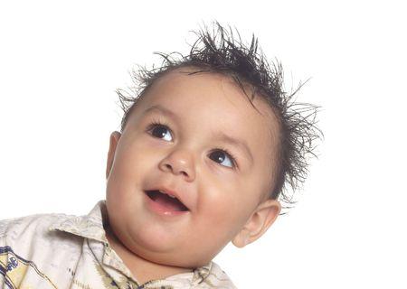 �spiked: Un adorable beb� sonriente muchacho con el pelo salvaje de pinchos  Foto de archivo