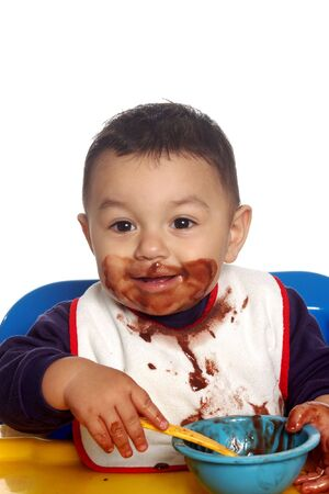 A  boy eating chocolate pudding Stock Photo - 742612