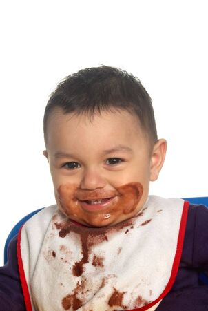 A  boy with a totally messy face from eating chocolate pudding Stock Photo - 939114