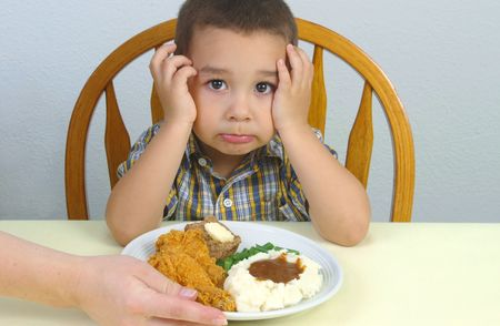 ready to eat: A young boy ready to eat his fried chicken dinner