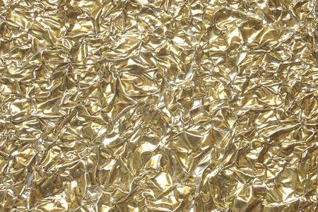 foil: Background texture of wrinkled gold foil