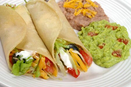 Mexican food - tacos, beans and guacamole photo
