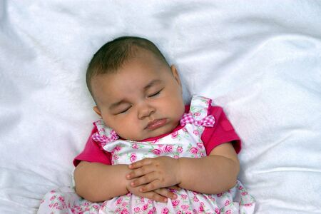 Horizontal portrait of a baby girl asleep on a fuzzy blanket Stock Photo - 1207933