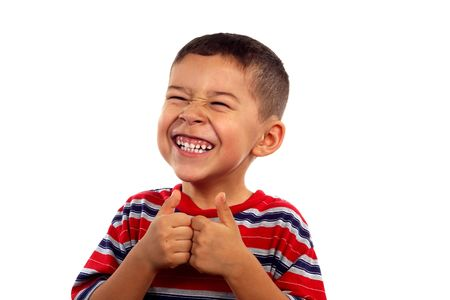 A young boy smiling and giving thumbs up sign