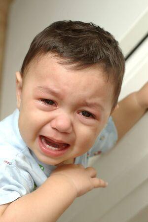 complain: A toddler boys tearful face