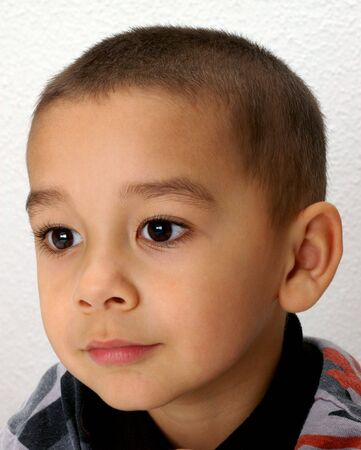 crewcut: Vertical portrait of a good-looking young boy Stock Photo