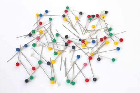push: Scattered push pins Stock Photo