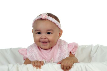bassinet: Adorable baby girl wearing a pink dress