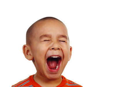 crewcut: Boy screaming, with plenty of copy space Stock Photo