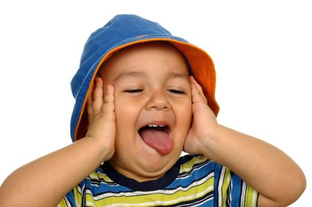 yuck:  boy sticking out his tongue with a hilarious expression Stock Photo