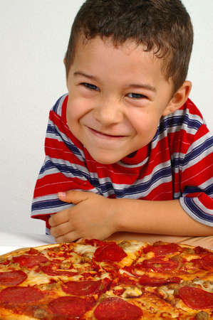 boy ready to eat a pepperoni pizza photo