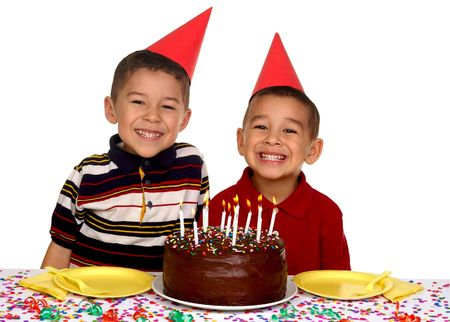 child food: Two young brothers ready to enjoy a birthday cake Stock Photo