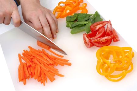 Chefs hands chopping fresh vegetables Stock Photo
