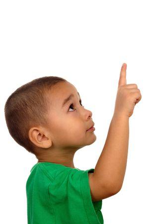 ni�os pensando: Retrato vertical de un muchacho joven que parece ascendente y que se�ala para arriba Foto de archivo