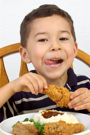 eating chicken: Boy ready to eat fried chicken dinner