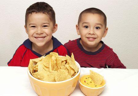 tortilla chips: Children eating chips snack