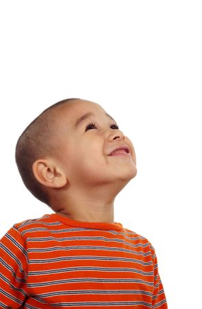 surprised child: Hispanic boy looking up on a white background