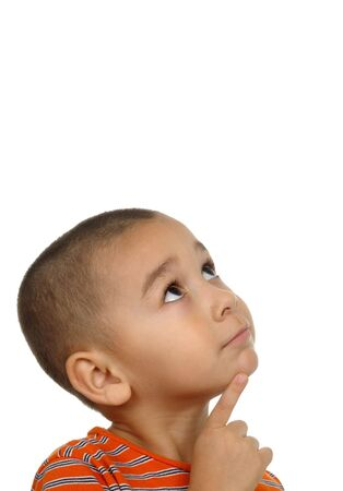 Hispanic boy looking up and wondering 版權商用圖片