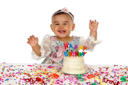 one year: One-year-old hispanic girl and birthday cake Stock Photo