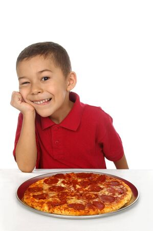 Hispanic boy and pepperoni pizza