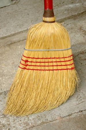 Vertical photo of a simple domestic corn broom
