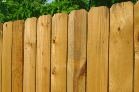 barrier: Wooden fence constructed of unfinished pine Stock Photo