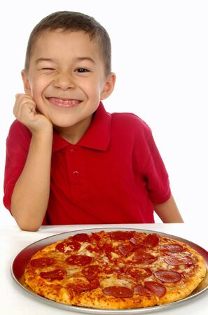 Kid and pizza 6 years old photo
