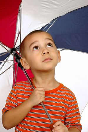 crewcut: a 5-year-old hispanic boy holding an umbrella Stock Photo